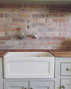 White Brick Backsplash painted brick backsplash, possible faux brick panels painted white