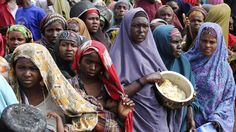 Internally displaced Somali women wait for food at a camp in the Somali capital, Mogadishu, on July 20, 2011. People in the rebel-controlled south and south-central parts of the country, whose livelihoods have been devastated by a combination of factors - from drought to conflict and global rises in commodity prices - have been left no choice but to walk for days to find food. Many of the thousands of families who managed to reach Mogadishu lost children along the way to starvation. (Omar…