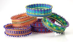 Pile of Small Bead Bracelets by Dorothy Siemens ($75 each).