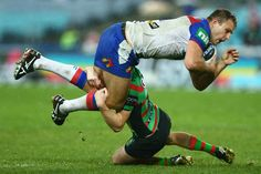 Robbie Rochow of the Knights is tackled during the round 12 NRL match between the South Sydney Rabbitohs and the Newcastle Knights at ANZ Stadium on June 1, 2013 in Sydney, Australia.
