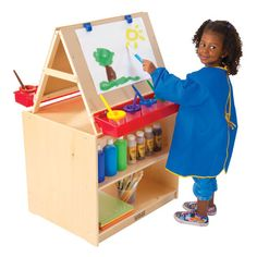 This art easel as a space for everything that is needed for painting. The art supplies are handy but out if the way of painting.