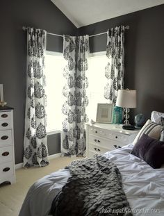 Master bedroom update.  DIY stenciled curtain panels.  Wall color:  Magnet, Behr Marquee