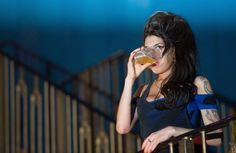 LONDON, ENGLAND - AUGUST 25: Amy Winehouse drinks a pint of lager as she watches The Libertines perform live at The Forum on August 25, 2010 in London, England. (Photo by Ian Gavan/Getty Images)