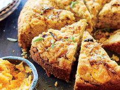 Cheddar-Caramelized Onion Bread Recipe | You may have grown up eating classic Southern cornbread at fish fries, but give this Cheddar-Caramelized Onion Bread a try at your next cookout. This bread has a very unique texture, largely due to the use of almond flour. Serve it alongside hearty soups and stews instead of the usual white bread. Be sure to prepare a batch of Whipped Sweet Potato Butter to go along with this tasty bread.