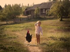 Russian Photographer Takes Marvelous Photos of Her Kids With Animals
