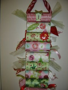 Advent Calendar DIY using toilet paper rolls! I love this! Cheap, but so cute! She even tells which scriptures to add to each roll!!