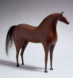 Figure of a standing red painted horse  American, Probably New England, circa 1880  Private collection