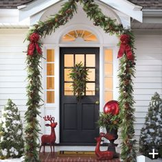 Love the garland up the columns instead of around the door