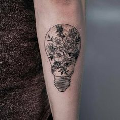 Fine line light bulb tattoo idea