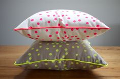 Neon Pink Spot Canvas Cushion. by September Designs, via Etsy.