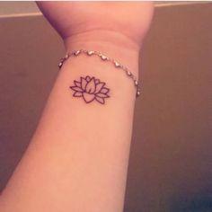 Lotus flower tattoo on Melina's left wrist.