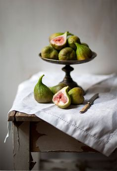 amazing... Fresh figs on a white table cloth.  Still life
