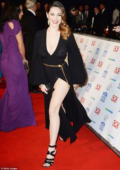 The thigh's the limit: Looking every inch the Hollywood megastar as she flashed her kilowatt smile, Kelly wore her brunette locks swept to the side and tumbling in a cascade of curls down her back
