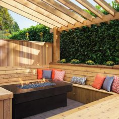 This combination cedar seating area and pergola create the perfect gathering spot for friends day or night.