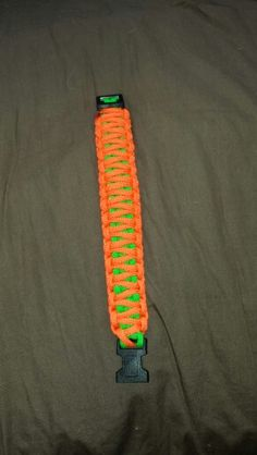 King cobra knot made with neon green and neon orange for a coworker