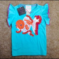 Lemon Loves Lime goldfish girl top 2T Gorgeous toddler girl top size 2T, by boutique brand Lemon Loves Lime. Brand new with tag. Hard to find. Excellent condition. Makes s great gift! Lemon Loves Lime Other