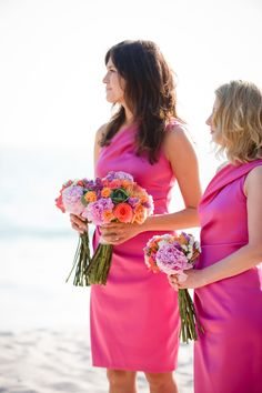 Short Vivid Pink Dresses for Bridesmaids -- More on SMP: http://www.StyleMePretty.com/destination-weddings/2014/05/28/beach-chic-punta-mita-wedding-at-casa-amore/ Photography: KLKPhotography.com