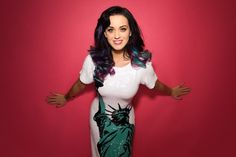 Katy Perry is one of those types girls who put wigs and all that stuff in there hair as you can see.But she is very pretty!