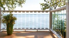 Deckorators Glass & CXT Railing system combines the durability of composite material with the visibility of glass balusters. Using straightforward baluster connectors, this system makes glass installation simple and DIY friendly. In stock in three finishes. Deck Railing Systems, Glass Railing System, Deck Railings, Glass Installation, Deck Design, Valance Curtains, Outdoor Spaces, Lights, Composite Material