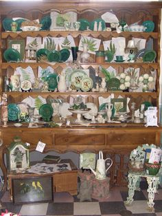 Green display with Majolica, Greenware, Alabaster, and fern prints...Nothing Ordinary Antiques.