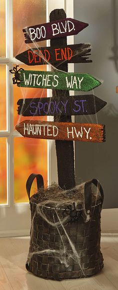 This would be cute on your porch mom @Lealeth Miller  crafts-n-things-spooky-directional-sign