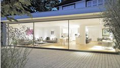 How a glass extension turned a traditional Thirties London terrace into an ultra-modern home - Ephraim McCaffrey Glass Extension, Extension Ideas, Roof Extension, Ultra Modern Homes, Foyer Lighting, House Extensions, Pergola Designs, Modern Glass, Glass House