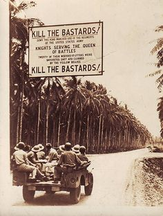 Kill the Bastards!    Kill the Bastards!    A sign hanging above a roadway to remind US soldiers to give no mercy to the enemy.