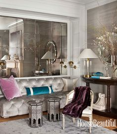 The plush silver couch and mirrored wall would be great for the end of a very big walk in closet!