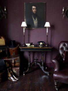 Eggplant bedroom, sitting room. Vintage furnishings, portrait.                                                                                                                                                     More