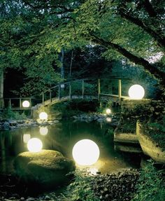 Floating Glow Orbs - Moonlight Globes float in your pool or lake and produce a beautiful but eerie glow. They are rumored to have a new product with a cool 360 degree s... #WaterGarden