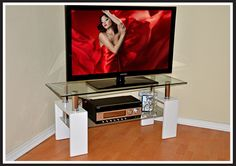 The Executive Plasma Tv Stand with its serious good looks will add a subtle charm to your living room.  Quality High Gloss Finish Tempered Glass top Trendy Modular Design Available in pre-assembled or Knockdown form Perfectly Matched with the Executive Coffee Table and 7 Piece Executive Dining Set Plasma Tv Stands, Plasma Table, Modular Design, Dining Set, High Gloss, Living Room, Coffee, Glass, Top
