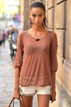 A local model salvages her favorite embroidered shorts from summer with a sheer fall knit top.