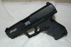 Walther PPQ M2 with awesome Talon rubberized grip and tacti-crayola lettering.