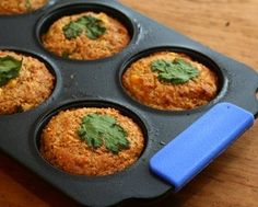 """Alanna Kellogg's Savory Cornbread Muffins... chili and cilantro within, cilantro leaf garnish on top, which, as you can see and as she points out, is """"pretty"""" indeed!"""