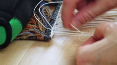 This tutorial video is about Tapestry Edging. Karen shows how she finishes the edges of a small tapestry diary by weaving the warp ends in a pattern across the width…