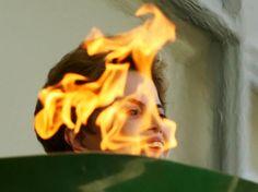 "Dida Sampaio para o jornal ""O Estado de São Paulo""  Tags: Dilma Rousseff, Olympic Games, Olympic Torch, flame, politics, brazil, corruption, impechment"