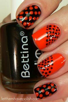 black + orange polka dots