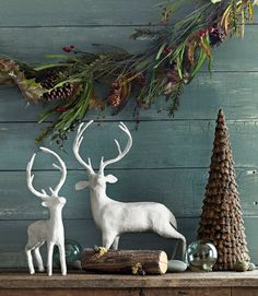 Christmas, with all I love...reindeer, glass floats, pine cone trees, and greenery