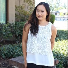 Sleeveless top with textured design. Chic versatile piece that can easily be dressed up or down. Also available in Medium and Large. Tops