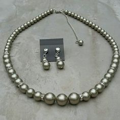 Check out this item in my Etsy shop https://www.etsy.com/listing/65239903/swarovski-platinum-pearl-necklace-and