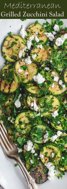 Mediterranean Style Grilled Zucchini Salad | The Mediterranean Dish. Simple, flavor-packed grilled zucchini with fresh herbs and other Mediterranean favorites. Ready in 15 minutes. Recipe from TheMediterraneanDish.com #zucchini #mediterraneandiet #meditrerraneansalad #zucchinirecipe #healthyrecipes #lowcarb #vegetarianrecipes #easyrecipes