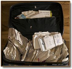 a suitcase of 300+ love letters