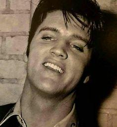 Elvis smiling a handsome smile.