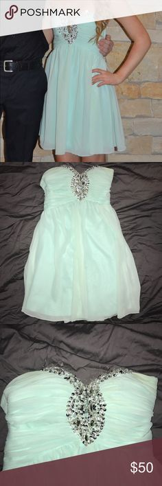 Formal dress Mint green dress! Sequins and Jems on the top! I wore it for my freshman sadies and it was super cute. Dresses