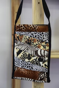 A beautiful crossbody bag with a variety of African wildlife patterns.  Stunning textures and an authentic African feel!