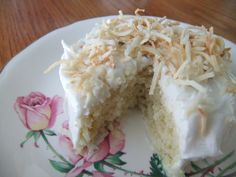 Lemon Coconut Cake -- A moist white cake with lemon and coconut throughout topped with a vanilla buttercream and toasted coconut Lemon And Coconut Cake, Toasted Coconut, Moist White Cake, Vanilla Buttercream, Food, Meal, Essen, Hoods, Meals