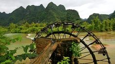 Bamboo water wheel. The use of water power for irrigation. Vietnam - HD stock video clip