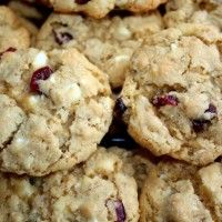 Oatmeal Craisin and White Chocolate Chip Cookies! So delicious, gooey and sweet! Note to self: only use 1/2 cup each chips and craisins, and 1/3 cup of each sugar! Makes 24 medium cookies.