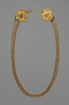 Golden necklace of three chains, which consist of intertwined gold wire loops. As the final members serve two deposits decorated with filigree wire and green glass gold discs on which the hook is attached.   The necklace comes from a richly decorated with offerings skeleton grave of a woman that was found in 1876 at Steeg on Lake Hallstatt. Migration Period, 2nd half of the 4th century AD