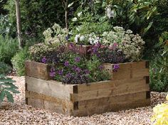 Square tiered sleeper raised bed, I will have a perfect place for this, could maybe incorporate a seat?
